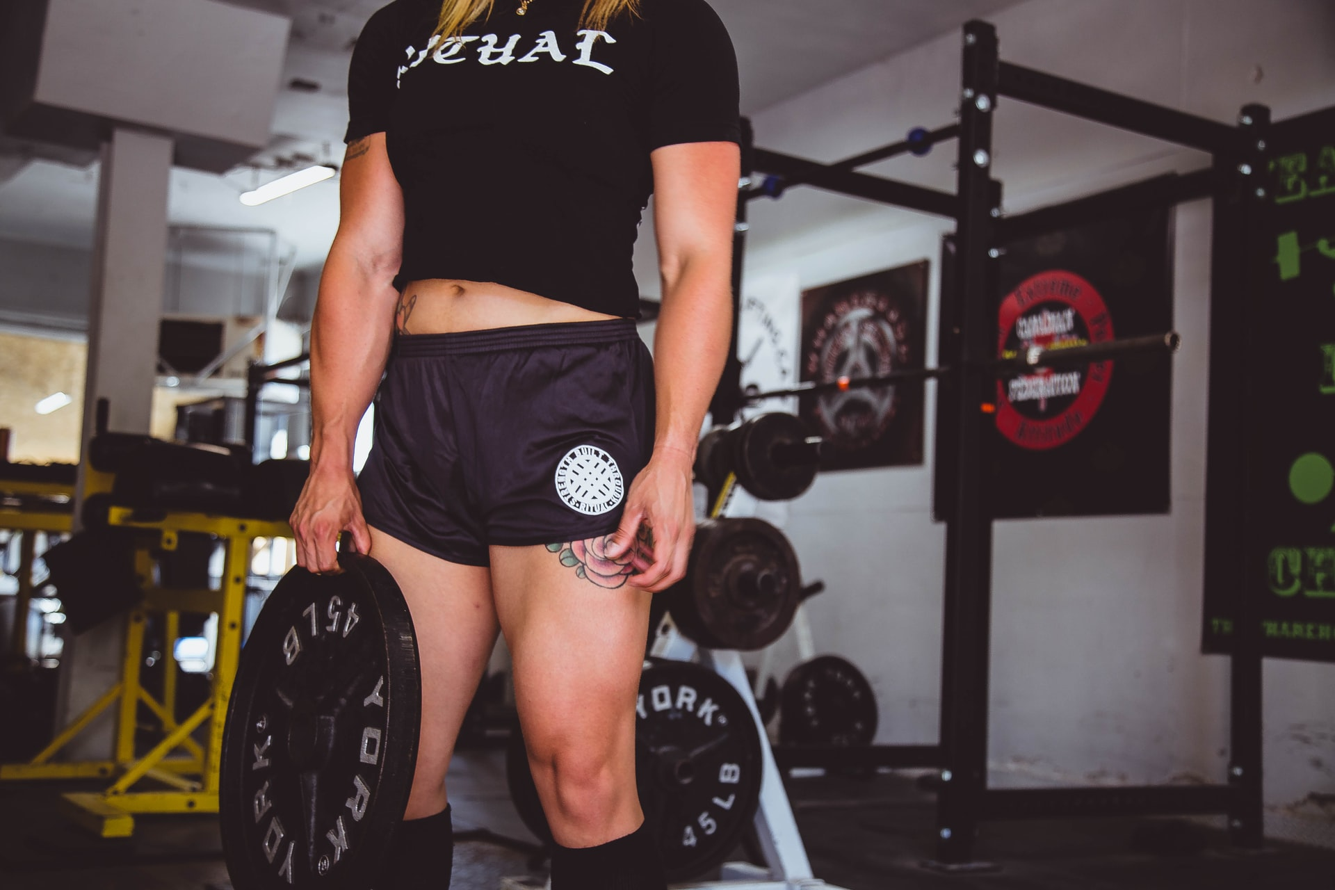 Woman holding black weight for workout